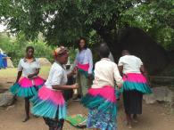 Downie dancing with members of the Lou tribe