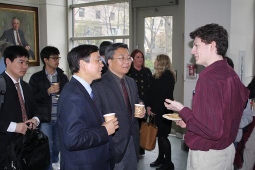 Professor Hou meets with a student during a reception preceding the lecture.