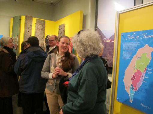 Curator Christy DeLair talks to visitors about the exhibit, Crafting Origins:Creativity and Continuity in Indigenous Taiwan.
