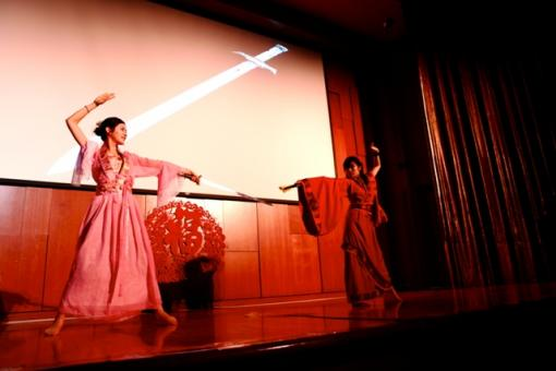 Two students captivate the audience with their stunning movements in this traditional Chinese dance.
