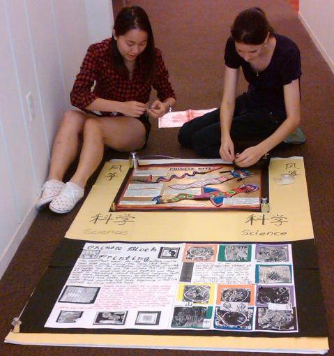 Brown University students help to set up the poster exhibit at the Science Center