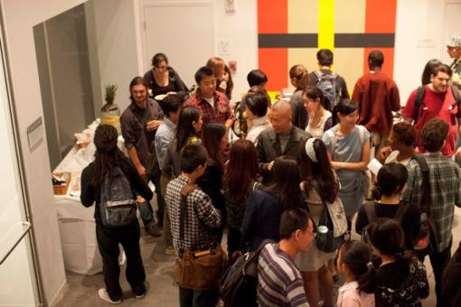 Students ask the artist questions during the exhibit's opening reception