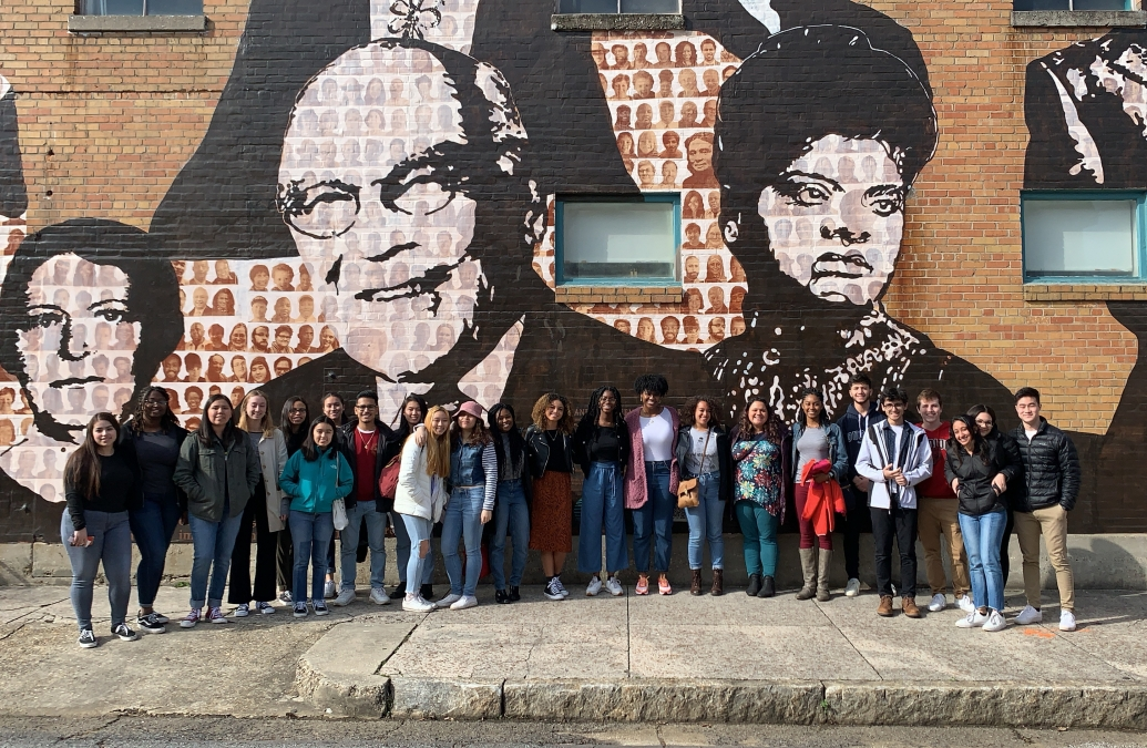 Students standing in front of a mural of civil rights leaders in Memphis, TN.