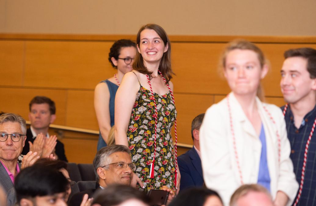 Students stand to receive recognition