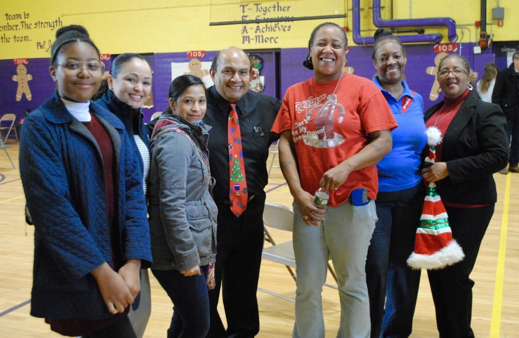 Abelardo Hernández with colleagues at D'Abate Elementary for the Gingerbread Express,