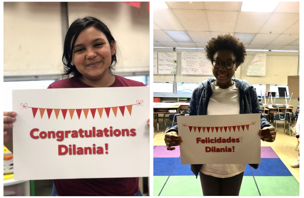 "Two students holding signs that read ""Felicidades Dilania!"" and ""Congratulations Dilania!"""