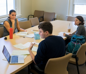 Brown's Juliet Hooker, Professor of Political Science, works with two students during her Latin American Political Thought class.