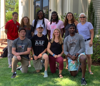 The 2019 Community Sport fellows pictured with program directors in from of the Swearer Center.