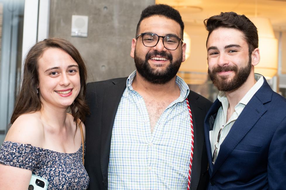 Three students smile at the camera