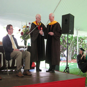 Professor Jim Head introduces Commander Scott at the Department's Commencement exercises in May 2011 when he received an honorary degree from the University