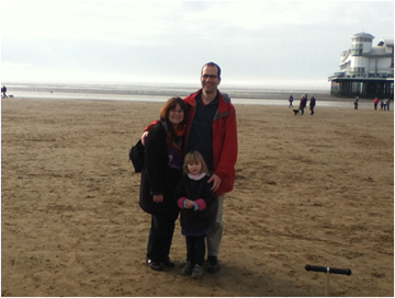 Karen with spouse Klaus, and daughter Katie on the beach at low tide in Weston-super-Mare, UK.