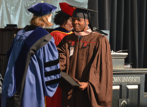 Dr. Lwabanya Marx Healthcare Leadership '17 receives the Master's Award for Professional Excellence at Commencement.