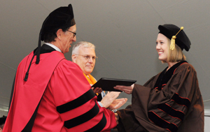 Jennfer R. Davis (Molecular Pharmacology and Physiology), receives one of four Outstanding Dissertation Awards, sponsored by the Joukowsky Family Foundation, at the May 2013 Commencement.