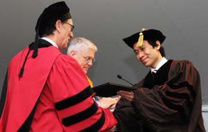 Michael Luk (Physics) receives a Joukowsky Outstanding Dissertation Prize at the May 2013 Commencement.