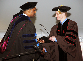 Jeffrey W. Miller (Applied Mathematics), receives one of four Outstanding Dissertation Awards, sponsored by the Joukowsky Family Foundation, at the May 2014 Commencement.