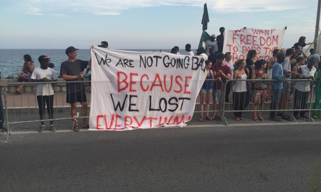 Eritrean refugees in Italy protest with sign: We are not going back because we lost everything