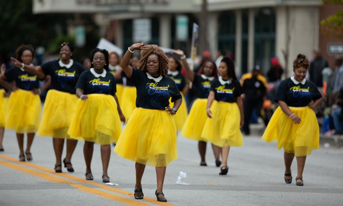 black sorority sisters march in parade