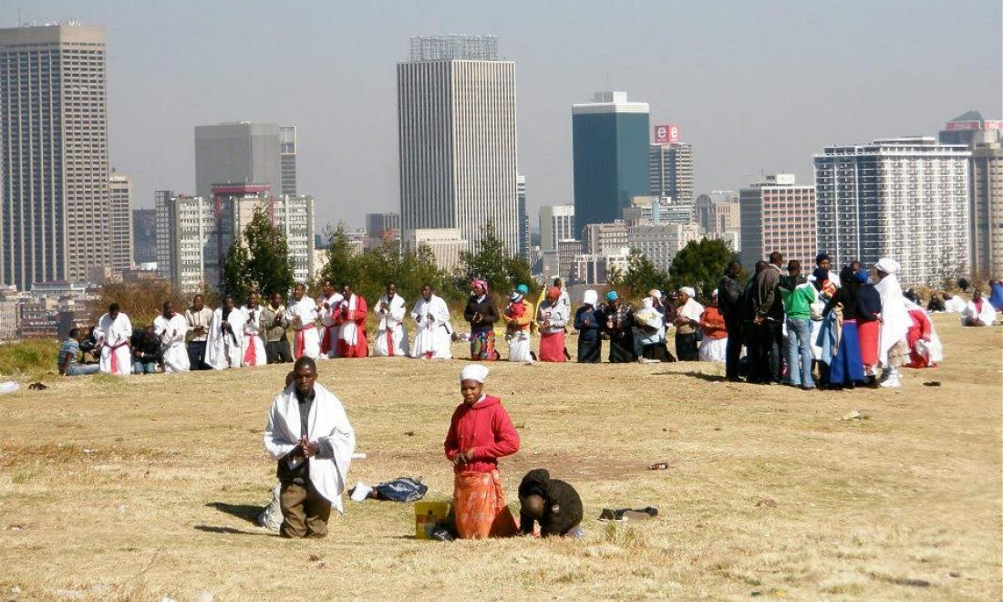 South Africa city skyline and religious meeting