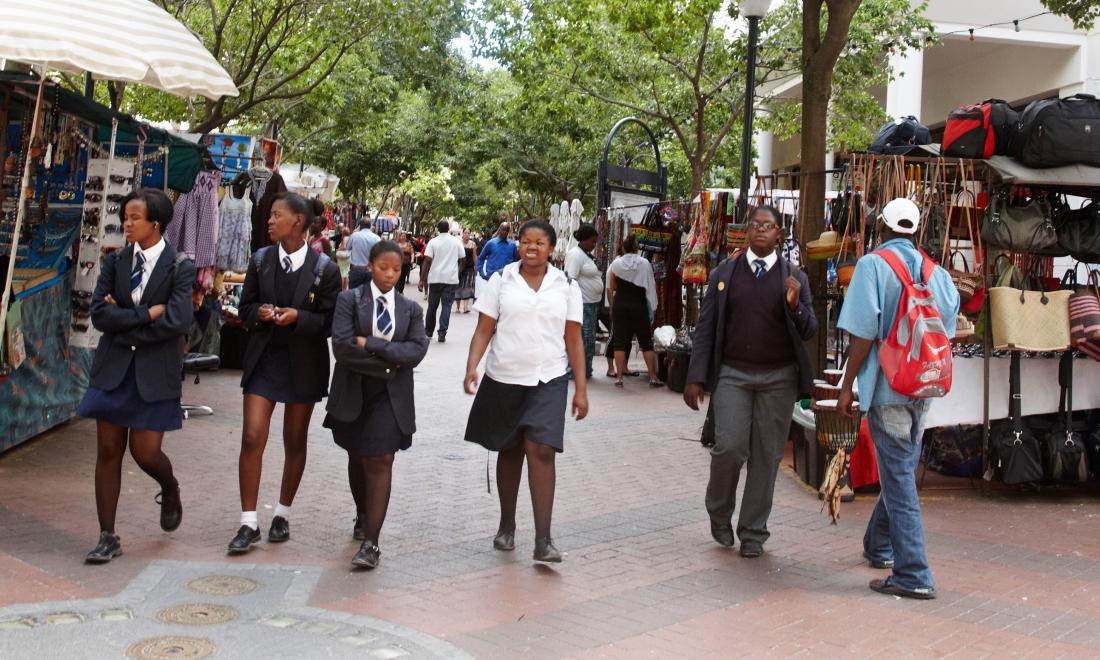 Teenage girls walk along the street in South Africa