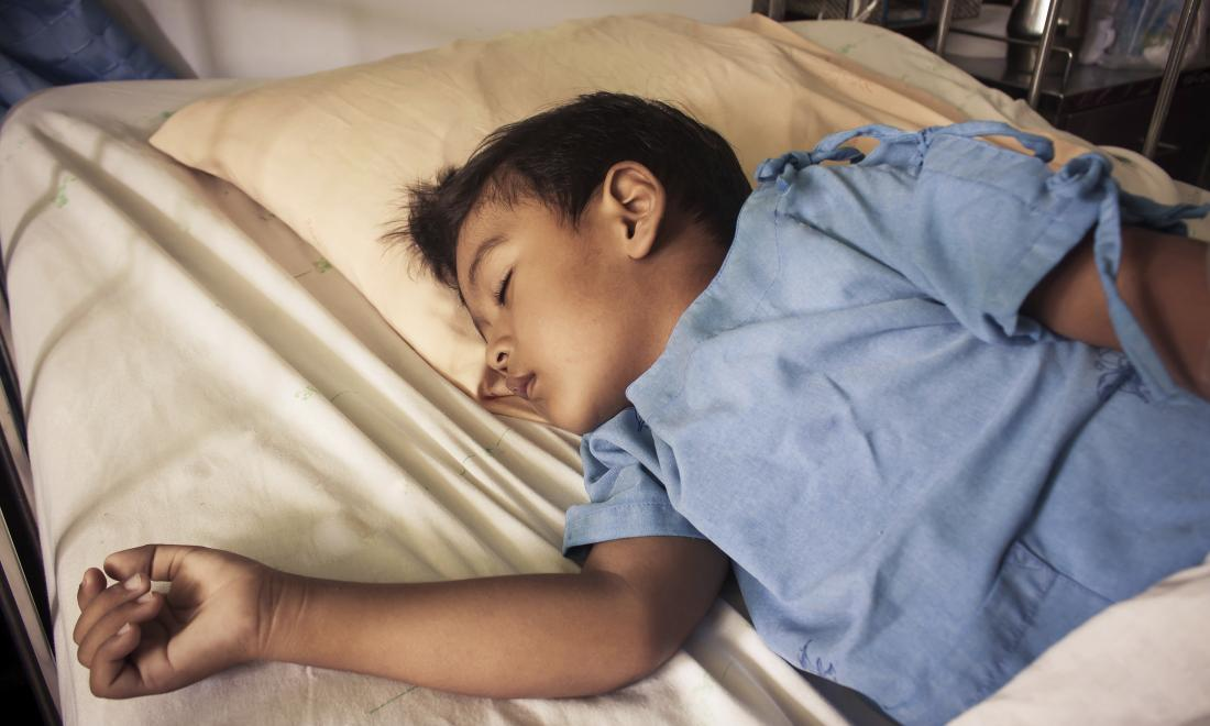Boy in hospital bed