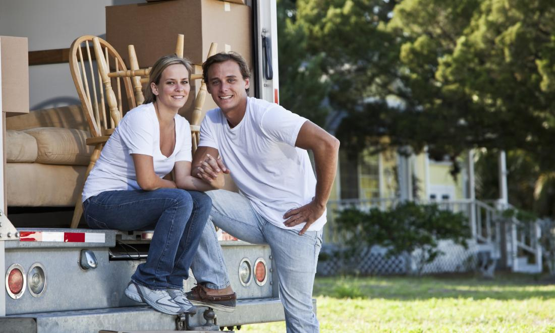 Couple in moving van