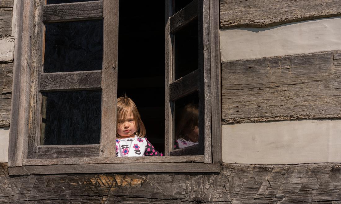 Little girl in window