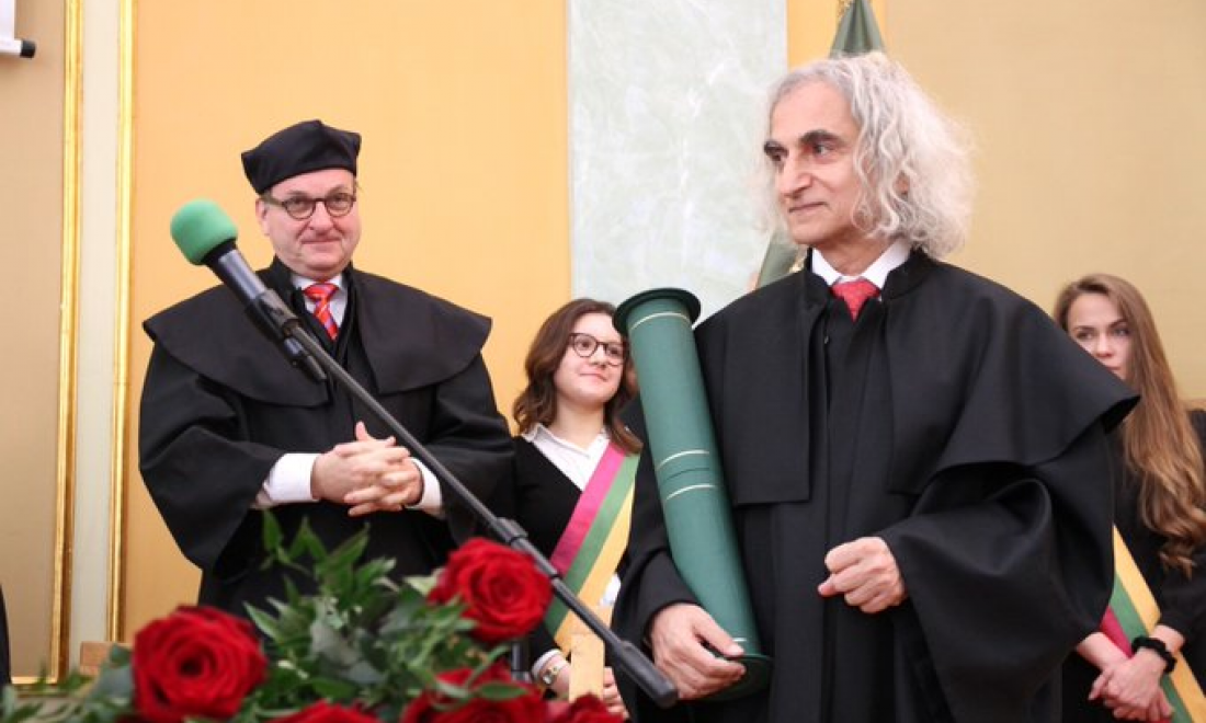 Galor accepting Doctor Honoris Causa