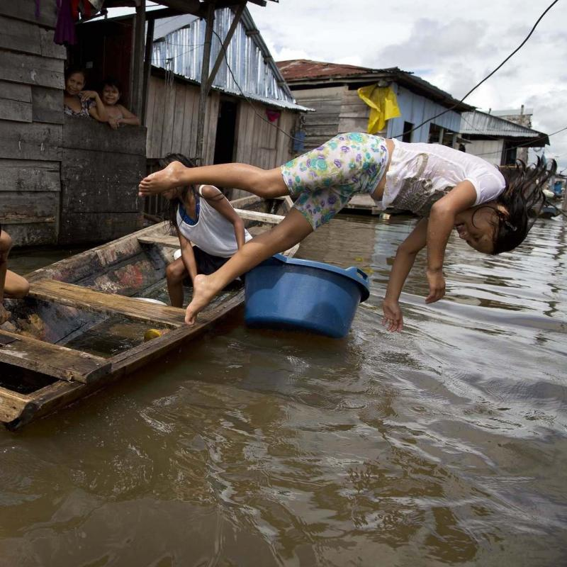 Peruvian children play in the Amazon community of Iquitos, which is nicknamed Venice of the Jungle because canoes are the most popular form of transport.