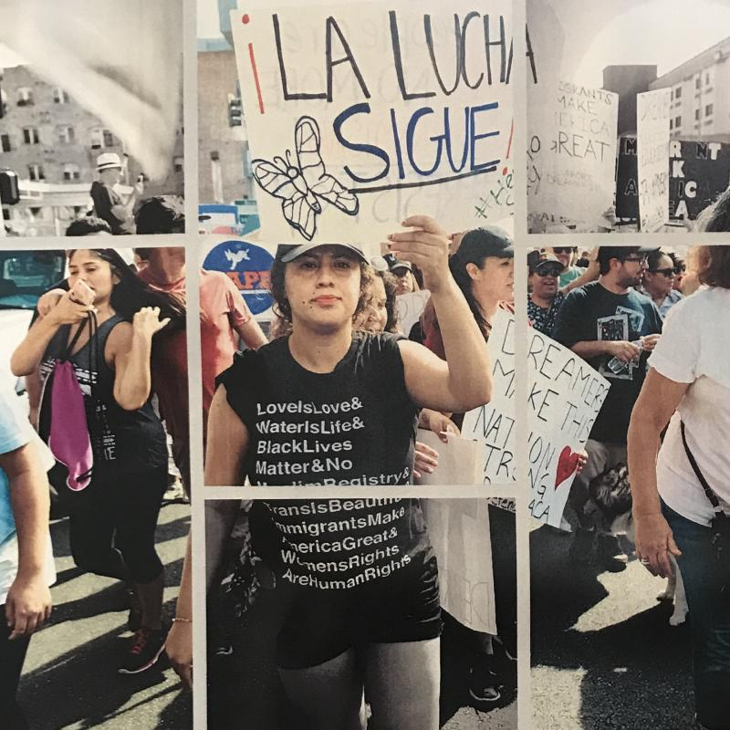 protesters march with signs in Spanish