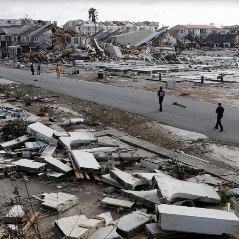 devastation and collapsed buildings following Hurricane Michael