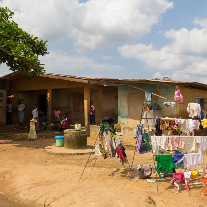 Nigerian home with well and laundry racks
