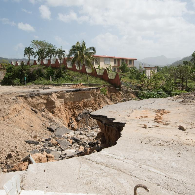 washed out road in Puerto Rico after Hurricane Maria