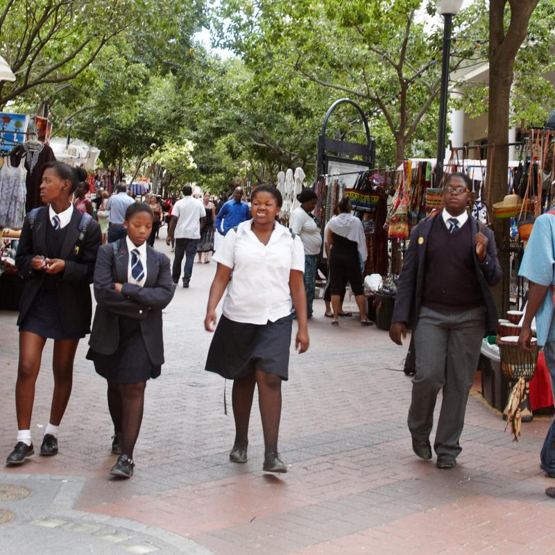 Teenage girls walk along the street in South Africa