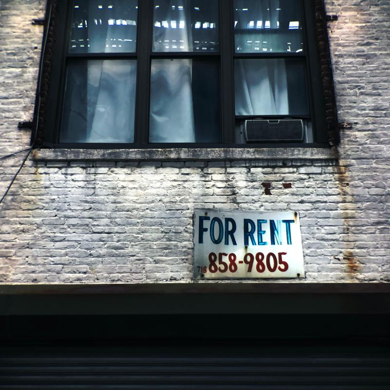 building - for rent sign