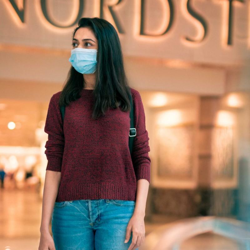 Woman shops wearing mask