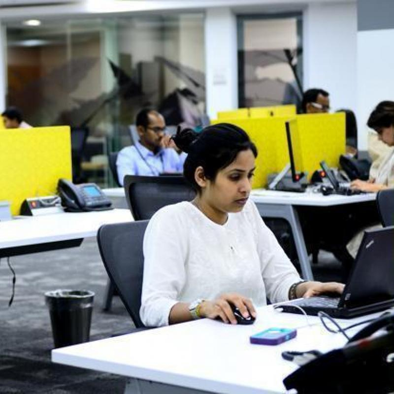 Indian women working in an open office space
