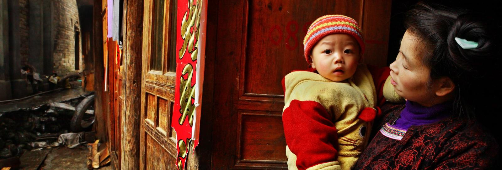 Chinese mother and child in village