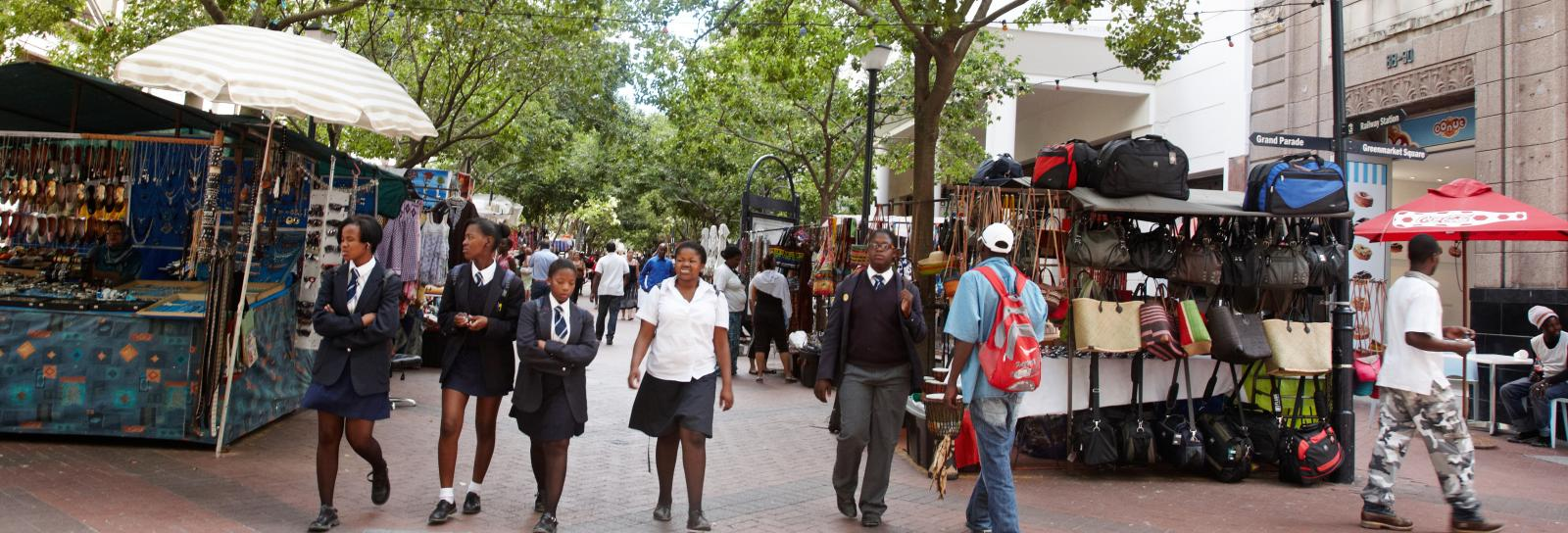 South African teens walking on busy city street