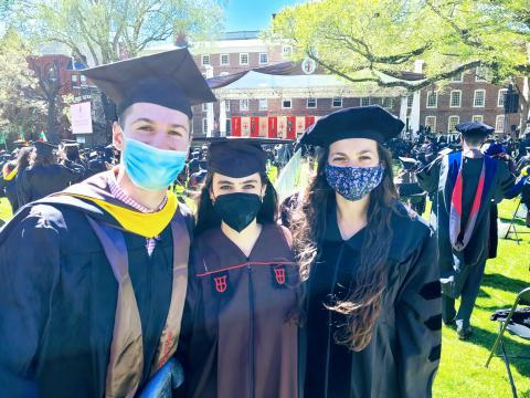3 Biostatistics Graduates standing on Brown's Green during Graduation