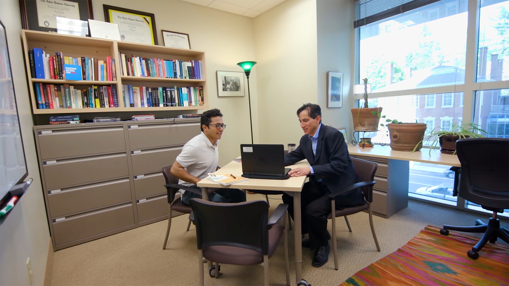 Student and Professor Collaborating