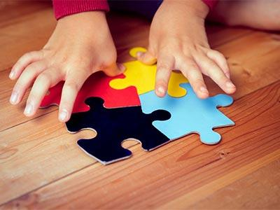 Hands and puzzle pieces