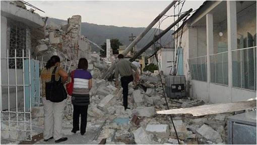 Drs. Sybil Cineas, Susan Cu-Uvin, and Timothy P. Flanigan navigate the ruins after the January 2010 earthquake.