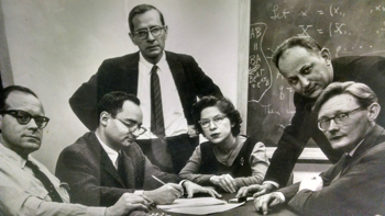 Joe LaSalle (standing center) collaborates with fellow mathematicians