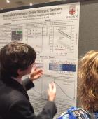 Ruben explains his research to participants of the Superfund Annual Meeting during the poster session on December 5.