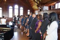 Students stand in preparation for induction 2014