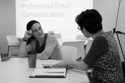 Participants asking questions during an English Language email workshop